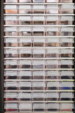 Rows of plastic boxes. For components stock images