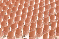 Rows of plastic chairs. Stock Image