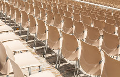Rows of plastic chairs. Stock Images