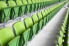 Rows of plastic seats in empty stadium Royalty Free Stock Images