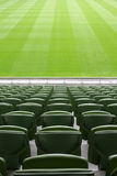 Rows of plastic seats in empty stadium Royalty Free Stock Photo