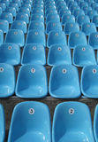 Rows of plastic seats at stadium Royalty Free Stock Images