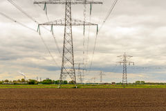 Rows of power pylons in a rural landscape Stock Photography