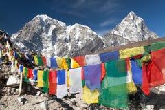 Rows of prayer flags and mount Arakam Tse Stock Image