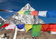 Rows of prayer flags and mount Arakam Tse Royalty Free Stock Image
