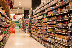 Rows of products in a supermarket Siam Paragon in Bangkok, Thailand. Stock Photography