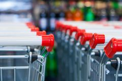 A rows of push carts in a supermarket. On the background of counters in blur Royalty Free Stock Photography
