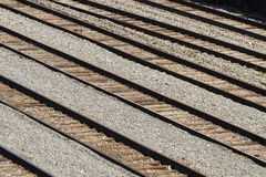 Rows Of Railroad Tracks In A Train Yard. Rows and rows of empty railroad train tracks in a railroad switching yard running in parallel to each other Stock Photo