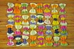Rows of rainbow pasta bows Stock Photo