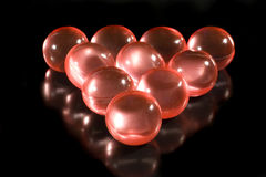Rows of red aromatic bath balls Stock Photos