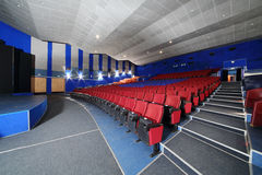 Rows of red, blue seats in Neva cinema Stock Image