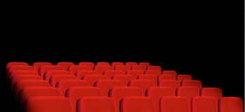 Rows of red cinema seats on a black background. Royalty Free Stock Photography