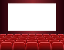 Rows of red cinema or theater seats with blank screen Royalty Free Stock Images