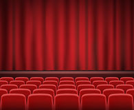 Rows of red cinema or theater seats in front of show stage. A Rows of red cinema or theater seats in front of show stage Stock Image