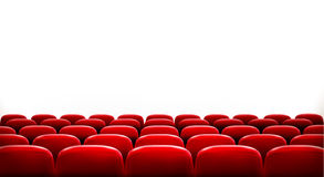 Rows of red cinema or theater seats. In front of white blank screen with sample text space. Vector Stock Photography