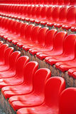 Rows of red empty stadium seats Royalty Free Stock Images