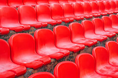 Rows of red empty stadium seats Royalty Free Stock Photography
