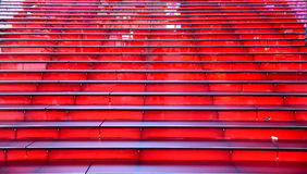 Rows of red Illuminating steps looking up with no people Royalty Free Stock Images