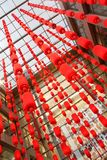 Rows of Red Lanterns. Hanging High At the Entrance of a Shopping Complex Stock Photo