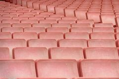 rows of red seats forming a repetitive pattern