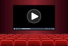 Rows of red seats in front of multimedia playing on a screen Royalty Free Stock Photos