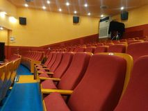 Rows of red seats inside a cinema Stock Image