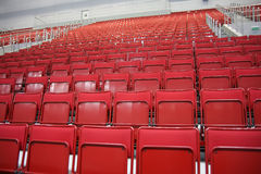 Rows of red seats at stadium Stock Image