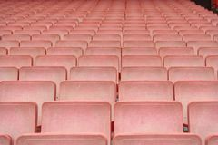 Rows of red stadium seats stock photography