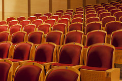 Rows of red theater seats Stock Photo