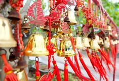 Rows of red wind bells golden buddhist prosperity bell at chinese temple people wish and hang them.  royalty free stock images