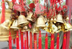 Rows of red wind bells golden buddhist prosperity bell at chinese temple people wish and hang them.  stock images