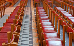 Rows of red wooden church pews Royalty Free Stock Images