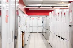 Rows of refrigerators in appliance store stock photos
