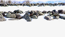 Rows of rocks in snow. 2 rows of stone barriers in the snow Stock Photography
