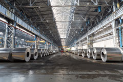 Rows of rolls of aluminum lie in production shop. Of plant Stock Photo