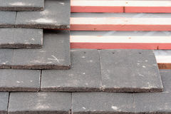 Rows of roof tiles being fitted to wooden battens Royalty Free Stock Photography