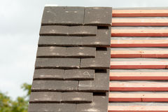 Rows of roof tiles being fitted to wooden battens Stock Images