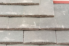 Rows of roof tiles being fitted to wooden battens Royalty Free Stock Images