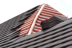 Rows of roof tiles being fitted to wooden battens Stock Photography