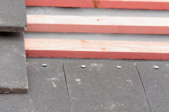 Rows of roof tiles nailed to wooden battens Royalty Free Stock Photo