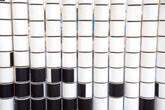 Rows of rotating cylinders in white and black for the development of children`s royalty free stock photos