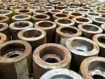 Rows of rusty pipe conecctions stock image