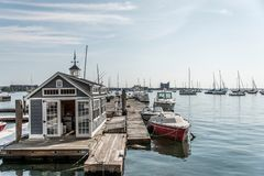 Rows of sailing boats and luxury yachts anchored in Boston harbor pier Names and trademark are revomed. stock photography