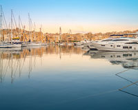 Rows of sailing boats on Senglea marina, Malta. Rows of sailing boats on Senglea marina in Grand Bay, Valetta, Malta, on a sunrise Stock Image