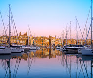 Rows of sailing boats on Senglea marina, Malta. Rows of sailing boats on Senglea marina in Grand Bay, Valetta, Malta, on a sunrise Royalty Free Stock Image
