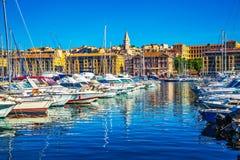 Rows of sailing yachts and fishing boats Royalty Free Stock Photos