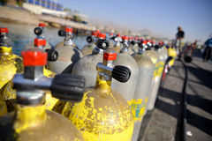 Rows of scuba tanks. Rows of scuba diving air tanks stock photography