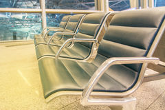 Rows of seats in airport lounge Stock Photos