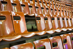 Rows of seats with broken one Royalty Free Stock Photography