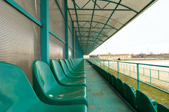 Rows of seats in an empty stadium. Green seats at the stadium Stock Images